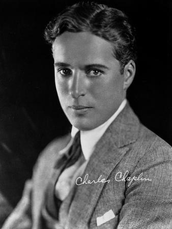 Charlie Chaplin in a Gray Suit and Tie with Signature