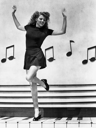 Rita Hayworth Music Notes Background in a Dancing Pose