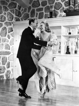 Fred Astaire and Ginger Rogers with Trophies on Cabinet