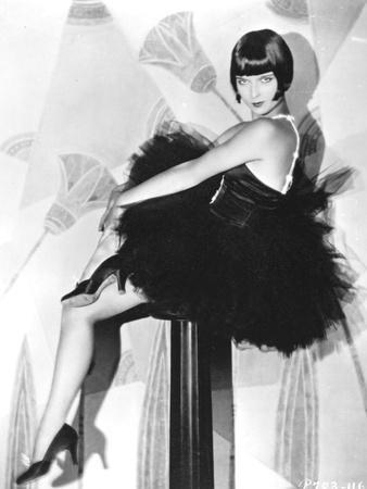 Louise Brooks sitting in Black Dress with Black Heels