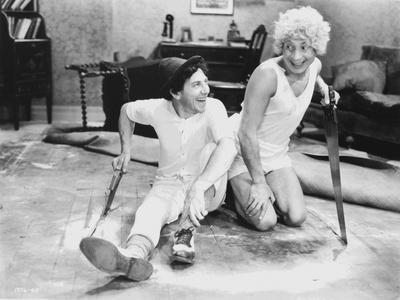 Marx Brothers sitting on the Floor wearing White Outfit
