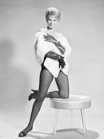 Angie Dickinson One Leg Kneeling on Table Black and White