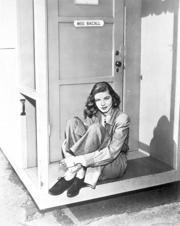 Lauren Bacall sitting with Legs Crossed in Black and White
