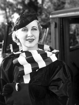 Genevine Tobin Posed in Black Dress and Striped Scarf