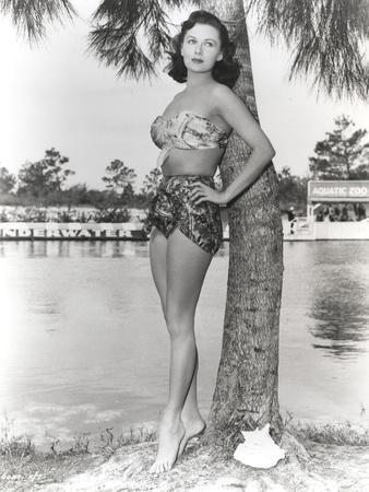 Rhonda Fleming Posed on a Tree wearing a Swimming Suit