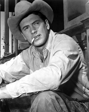 Rock Hudson Posed in Cowboy Outfit With Cigarette in Mouth