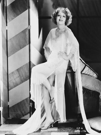 Clara Bow Posed in White Dress with Hands on Hips