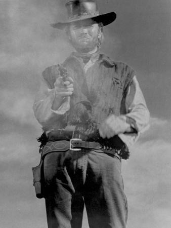Clint Eastwood Posed in Cowboy Outfit with Pistol