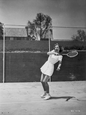 Barbara Stanwyck Playing Tennis in Classic Portrait