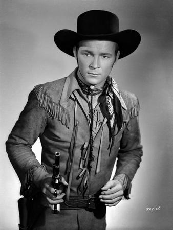 Roy Rogers posed in Cowboy Outfit and Holding a Gun