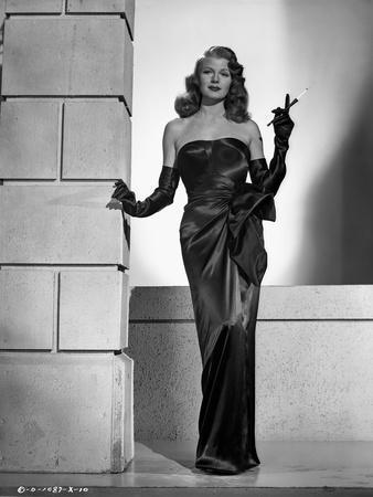 Rita Hayworth Posed in Black Dress with Cigarette Holder