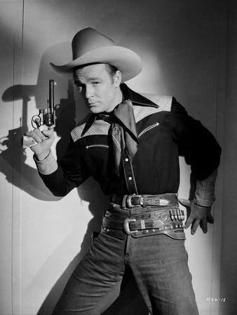 Roy Rogers posed in Cowboy Outfit Holding a Revolver