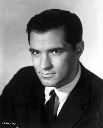 John Gavin Posed in Black Suit With White Background