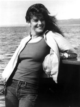 Debra Winger Posed in White Coat and Black Tank Top