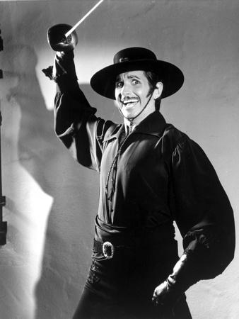 George Hamilton Posed in Cowboy Outfit With Sword