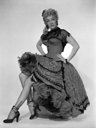 Marlene Dietrich Seated on a Barrel in Black Dress