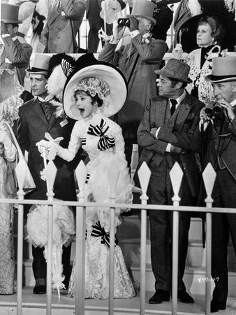 Audrey Hepburn Looking Shocked in Long Gown with Hat