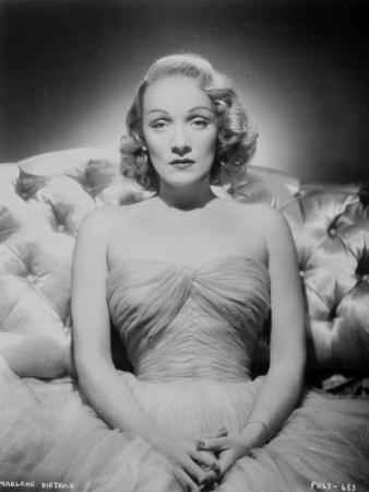 Marlene Dietrich Portrait on a Couch wearing Dress