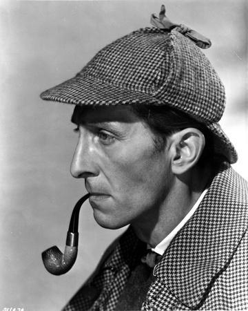 Peter Cushing Posed in Side View With Tabaco