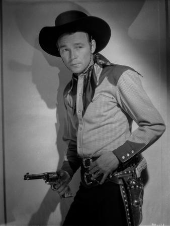 Roy Rogers Leaning on Wall and Holding a Revolver