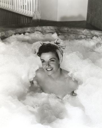 Jane Russell Posed on a Bath Tub with a Head Towel