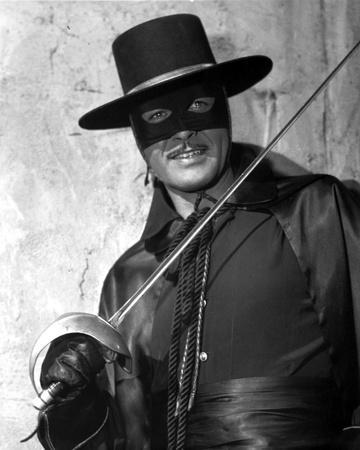 Guy Williams in Black Suit With White Background