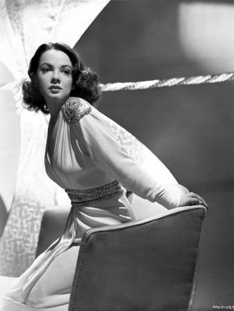 Kathryn Grayson on a Long Sleeve sitting on a Couch