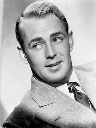 Alan Ladd smiling and Looking Away at the Camera
