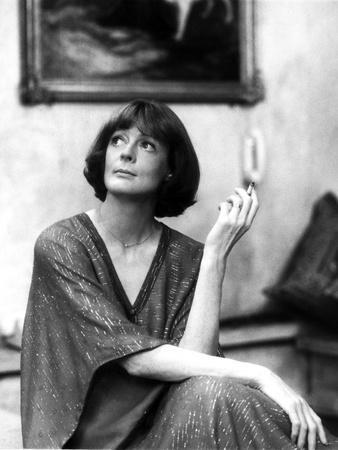 Maggie Smith Looking Up in Fancy Dress with Cigar