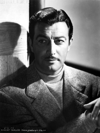 Robert Taylor Posed in Turtle Neck Shirt and Suit