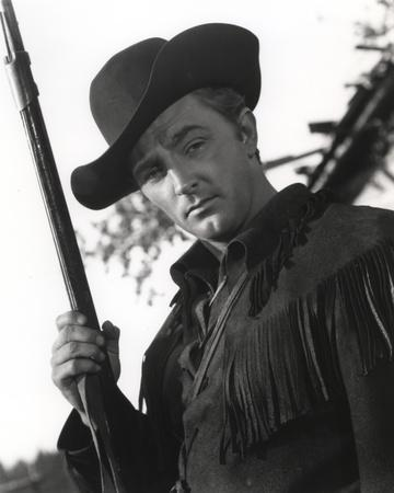 Robert Mitchum Holding a Rifle in a Western Outfit