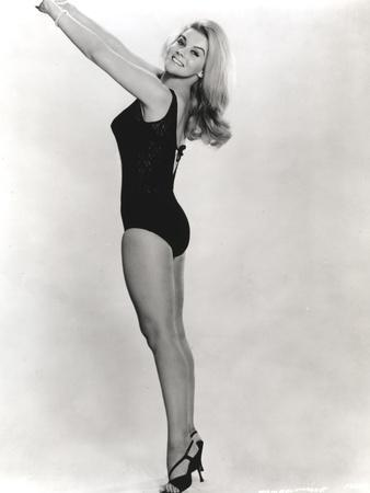 Ann Margret Stretching While Taking a Picture