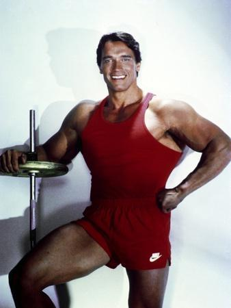 Arnold Schwarzenegger posed in Red Gym Outfit
