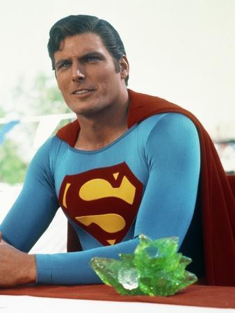 Christopher Reeve sitting in Superman Costume