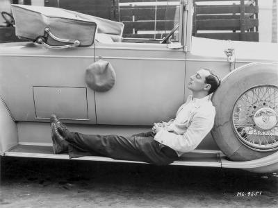 Buster Keaton posed on a Vintage Car in a Suit