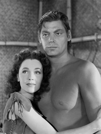 Johnny Weissmuller hugging a Woman while Topless