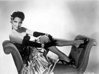 Julie London on a Silk Skirt sitting on a Chair