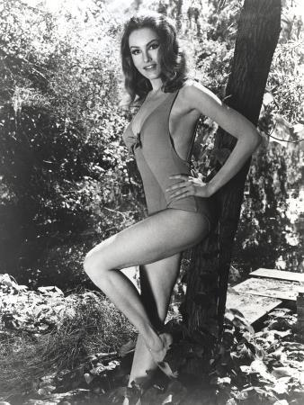 Julie Newmar Leaning on Tree in Lingerie Outfit