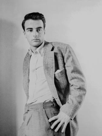 Montgomery Clift Leaning on a Wall wearing Suit
