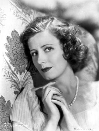Irene Dunne on a Dress wearing Pearl Necklace