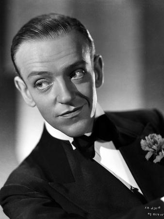 Fred Astaire smiling in Suit and Black Bow Tie