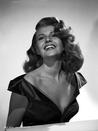 Rita Hayworth Portrait in Black Dress laughing