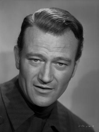 John Wayne wearing a Black Outfit in a Portrait