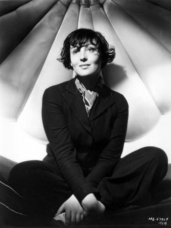 Luise Rainer on a Long Sleeve Top and sitting