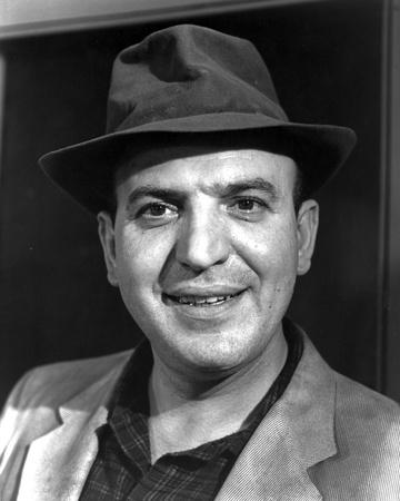 Telly Savalas Posed in Formal Attire With Hat
