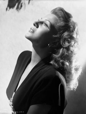Rita Hayworth Looking Up in a Side View Pose