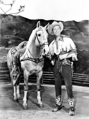 Roy Rogers posed with Horse in Cowboy Outfit