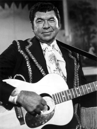 Claude Akins Playing Guitar With Black Suit
