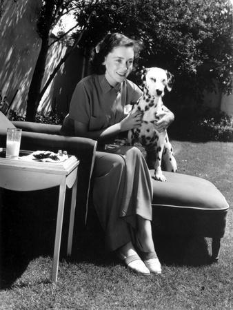 Maureen O'Sullivan sitting with a Dalmatian