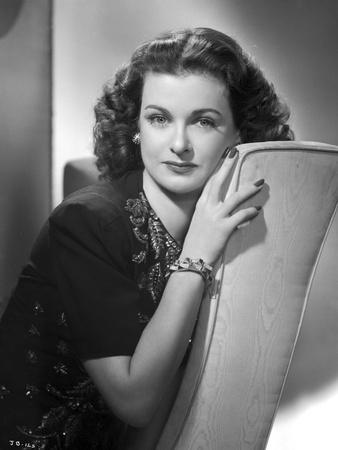 Joan Bennett on a sitting and Leaning Pose